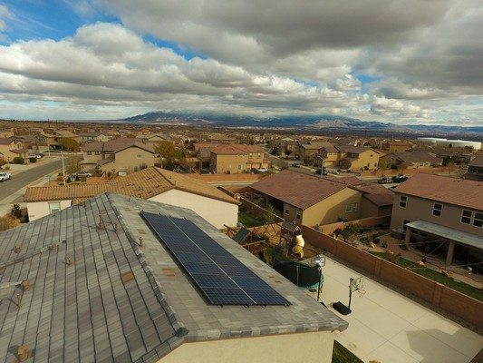 A tile roof house with solar panels put up by a solar company in El Paso.