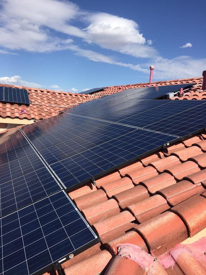 A clay rooftop with some Las Cruces solar panels