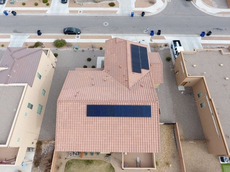 A house with solar panels put up by a solar company in Anthony TX or NM